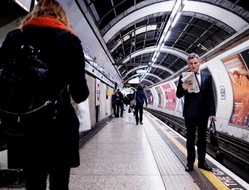 24-hours-on-the-london-underground-night-tube-street-photography-tarikahmet-man-reading-paper-tube