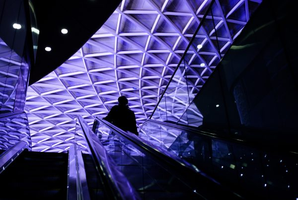 Silhouette of a man standing on an elevator at Kings Cross Station captured by Oh Brother Creative offering Video Production London
