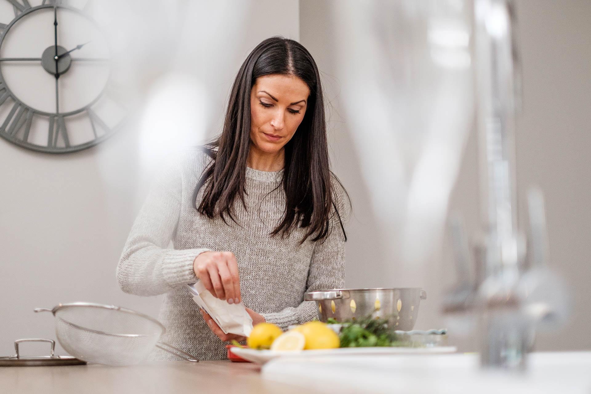 Insitu portrait of femal cook in kitchen