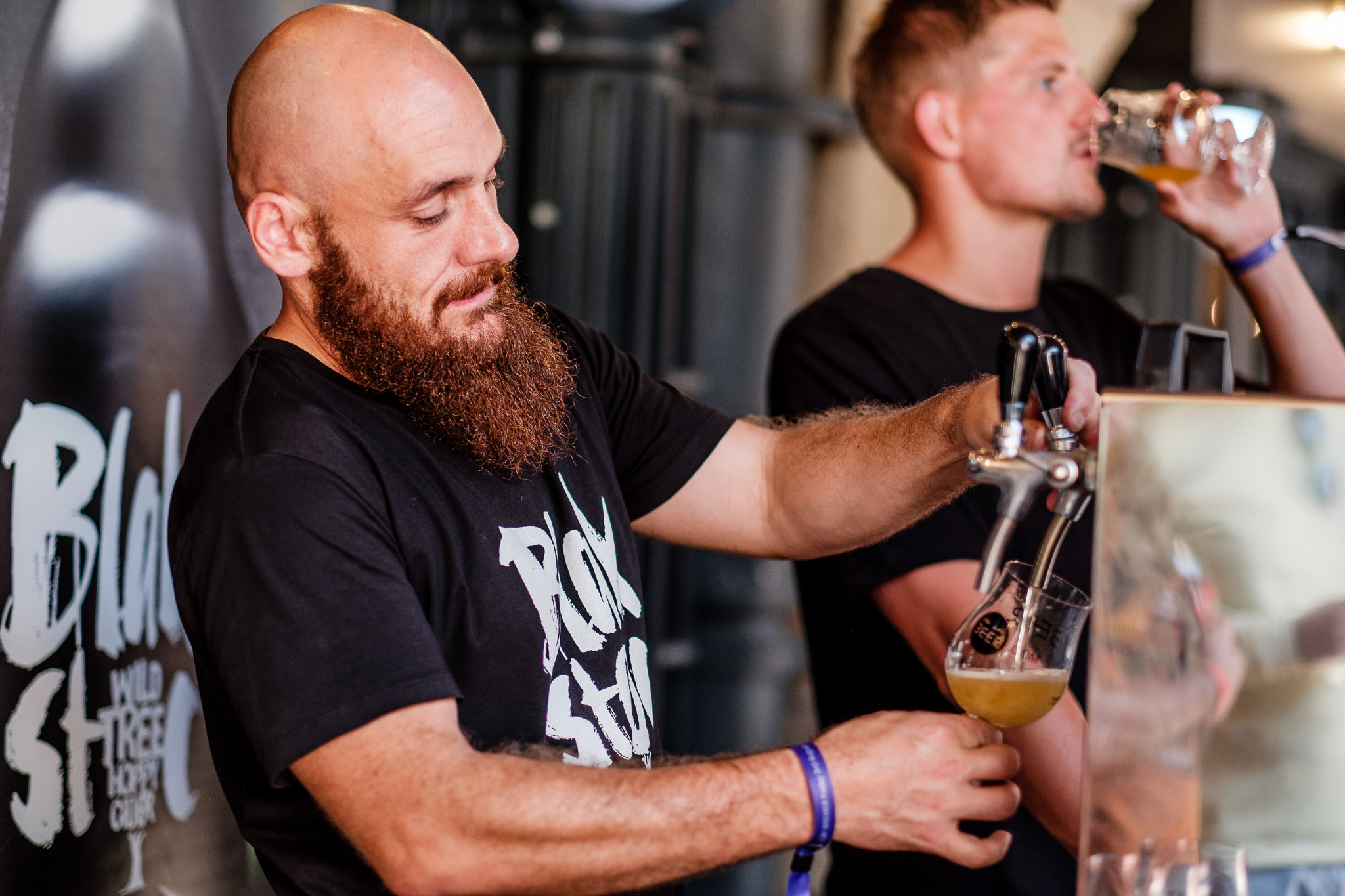 Man pouring a pint of beer at the London Craft Beer Festival