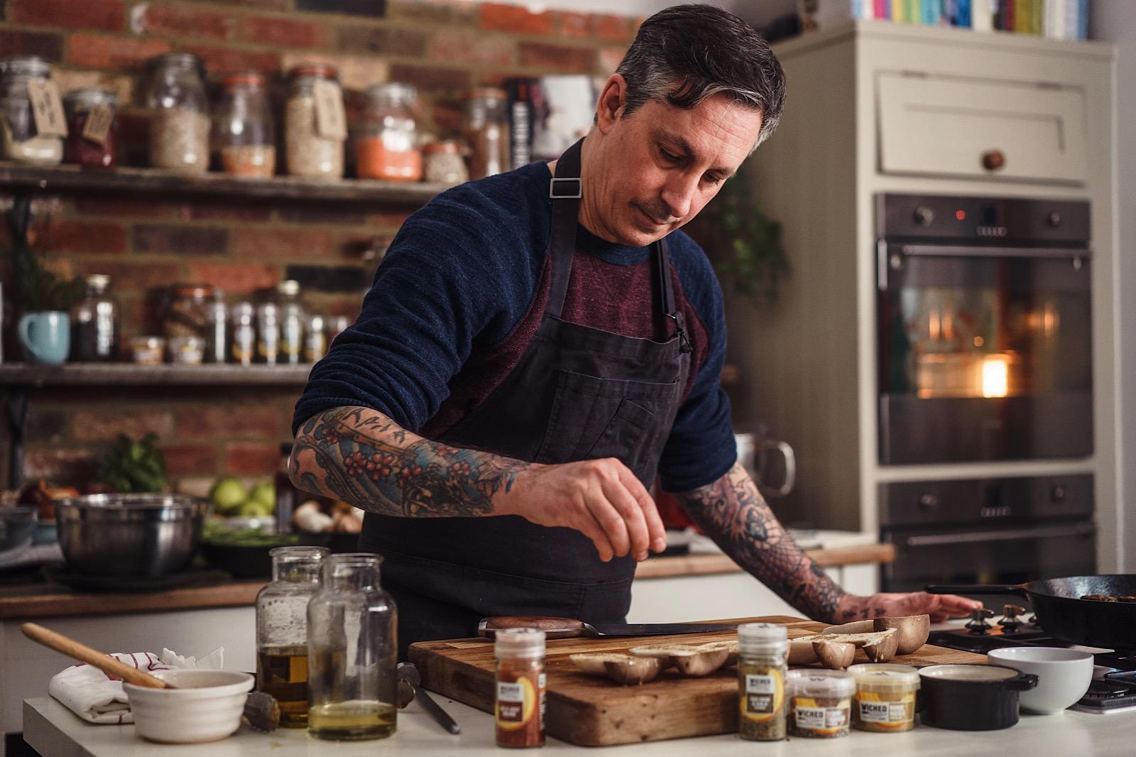 Chef Derek Sarno of Wicked Kitchen seasoning mushrooms during London Food Photography shoot for Tescos