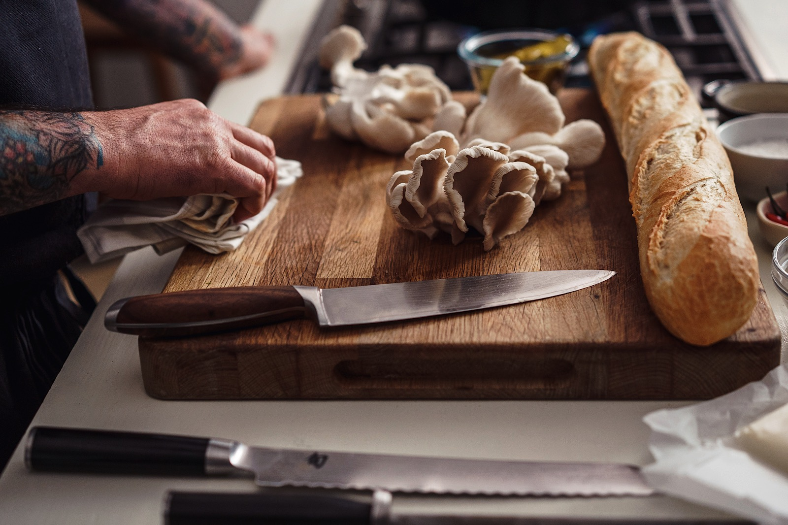 London Food Photo showing mushrooms and baguette on chopping board with knife
