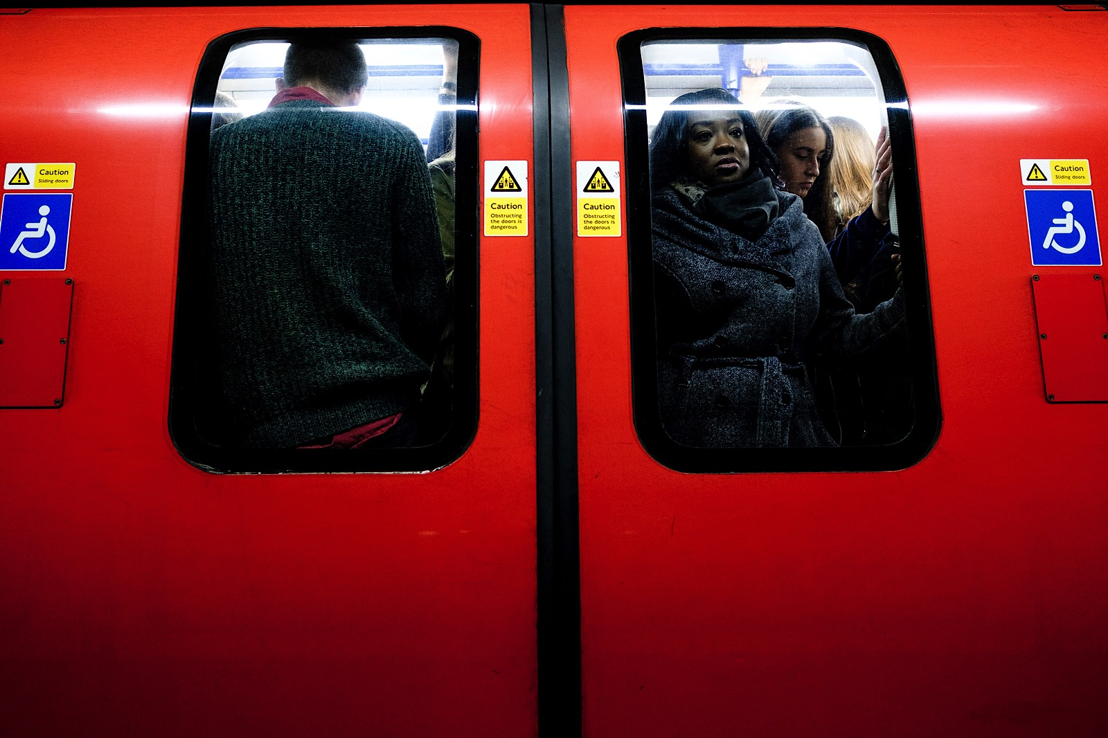 Street Photo of people crammed on a train on the London Underground