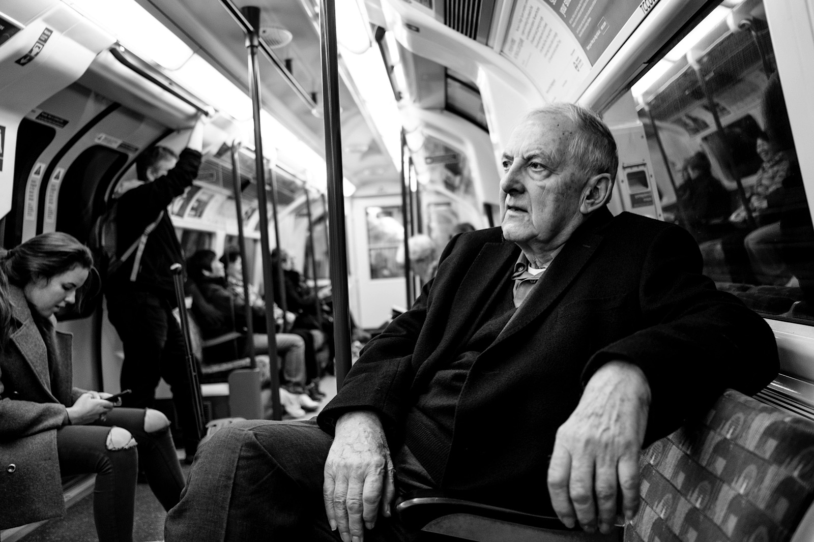 Candid Portrait of a old man sitting on a train