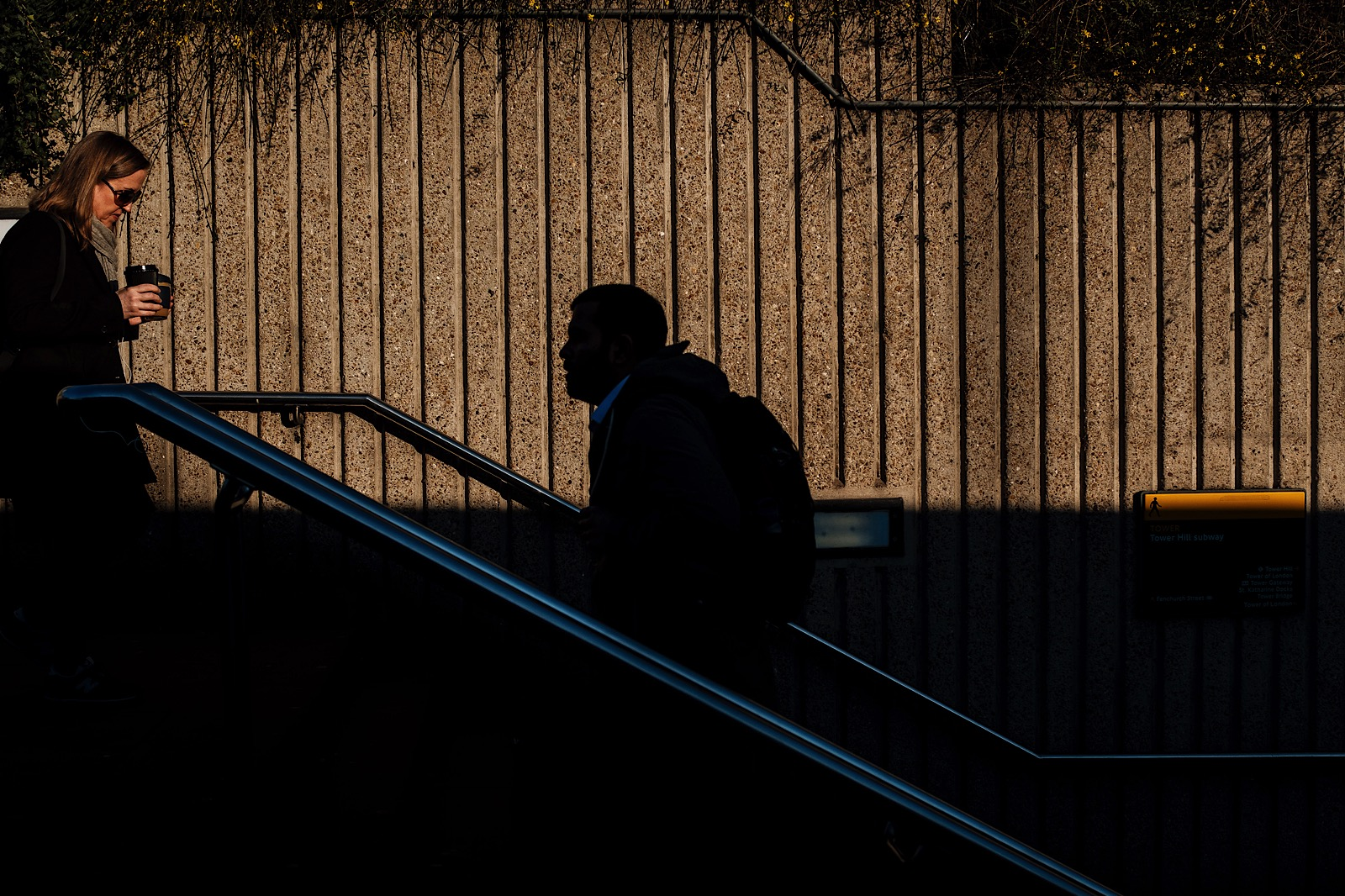 Street Photography of a man in shadow and a woman in light