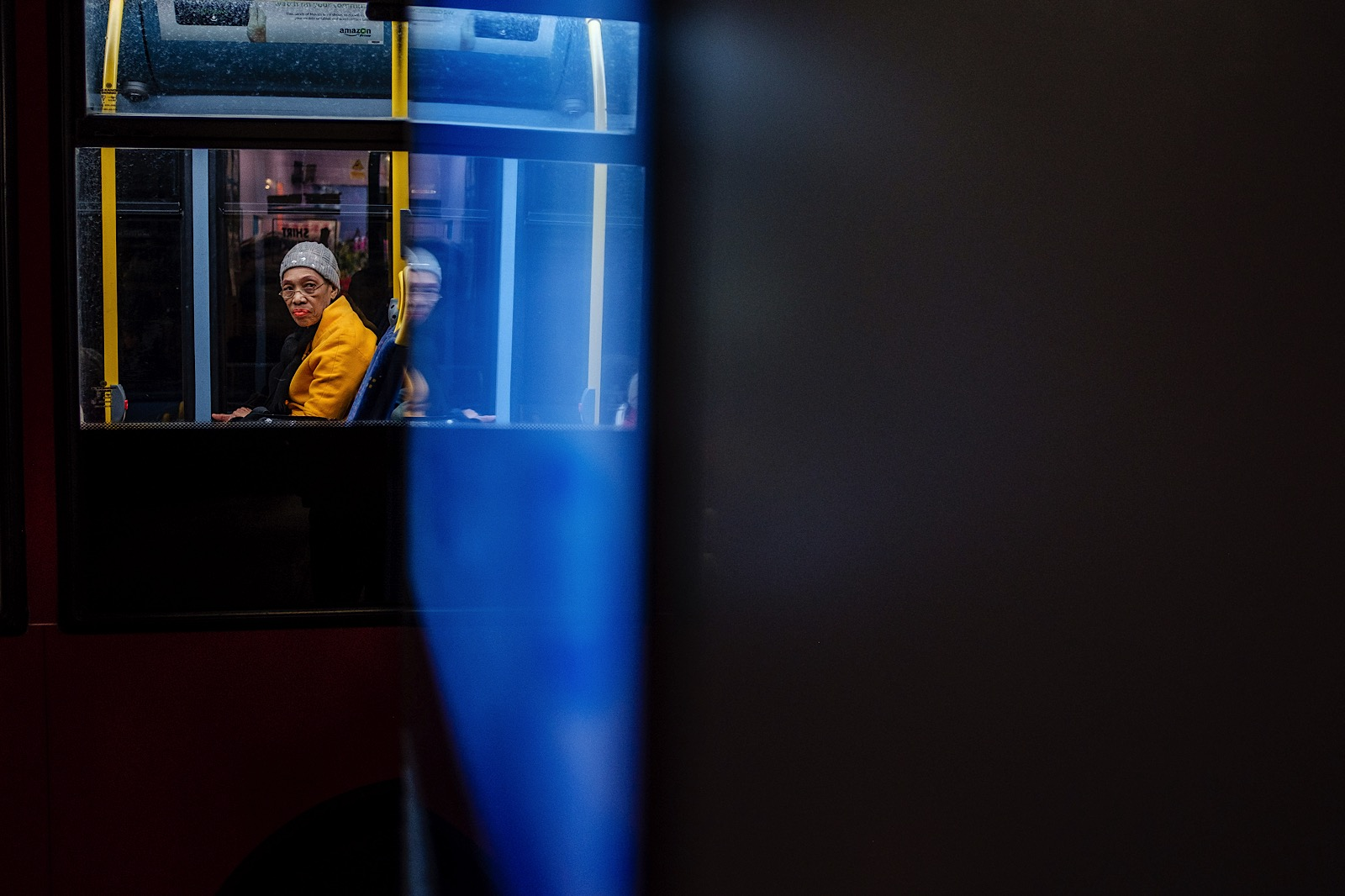 Photo of a woman looking out of a bus in Brixton