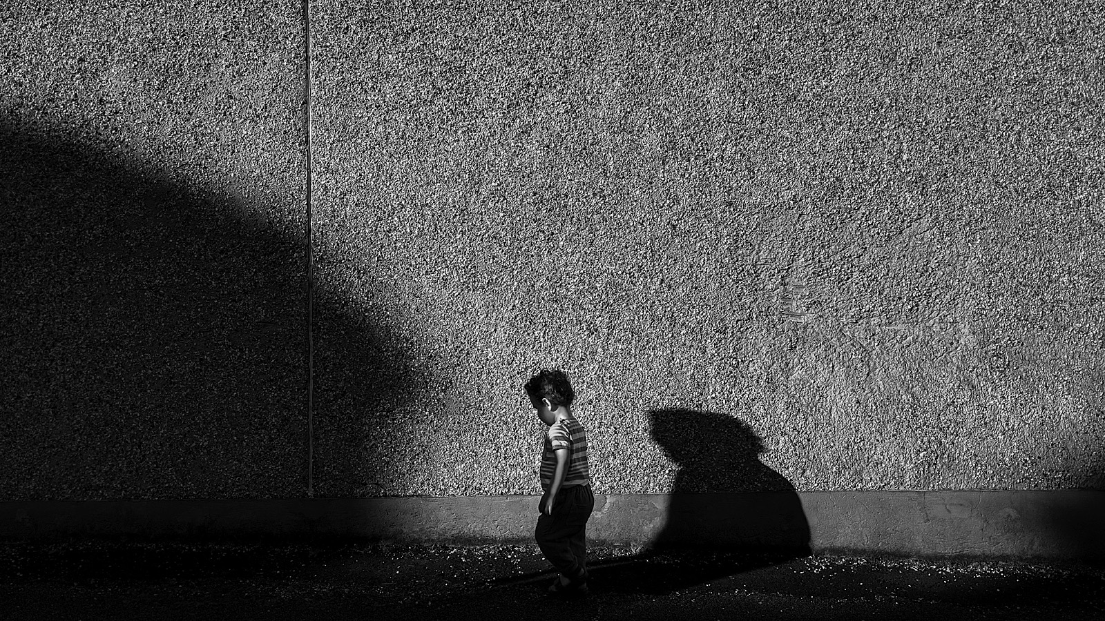 Street Photography of a young child against contrasting shadows