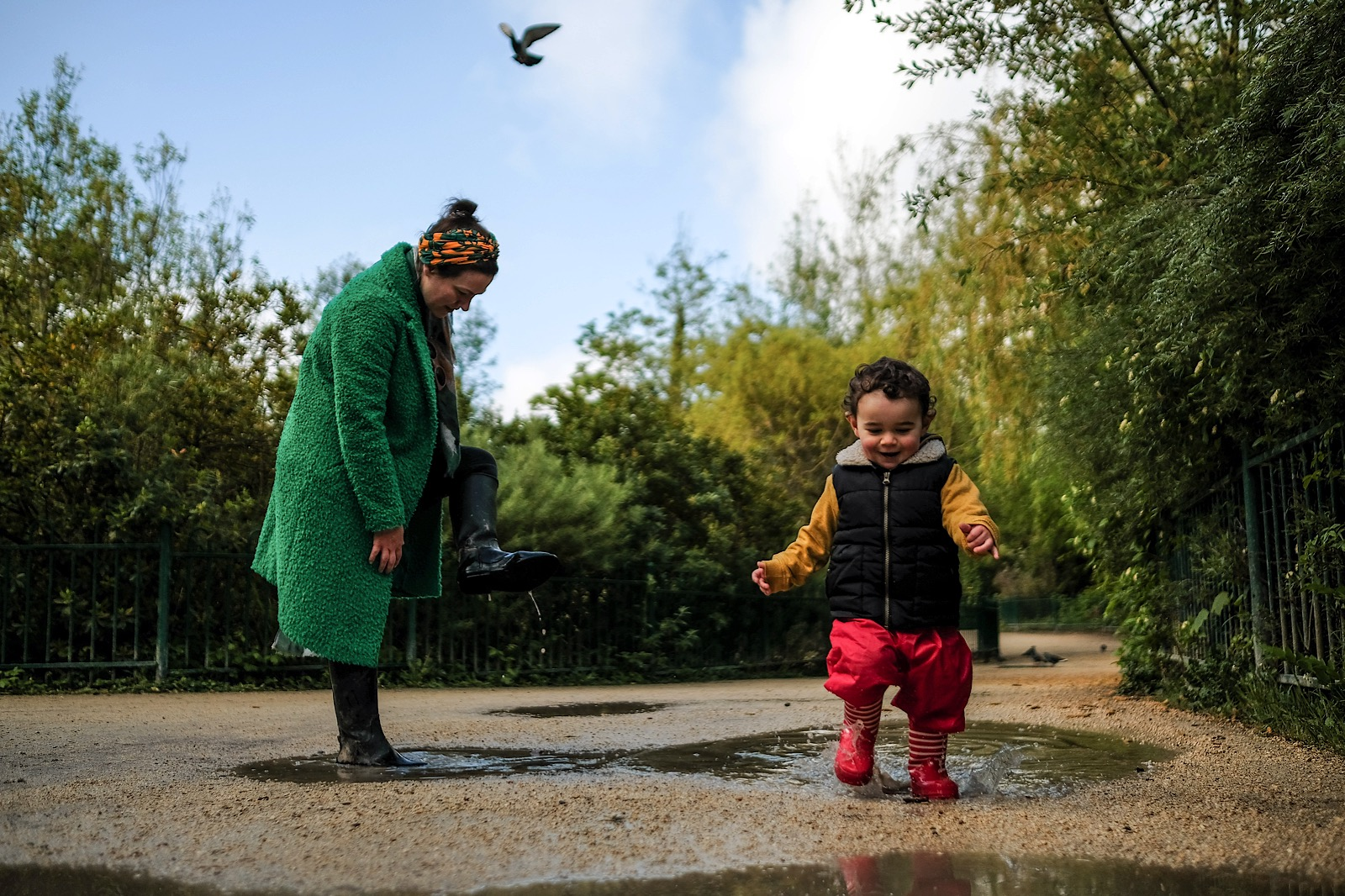 mother and son splashing in puddles during the covid-19 pandemic