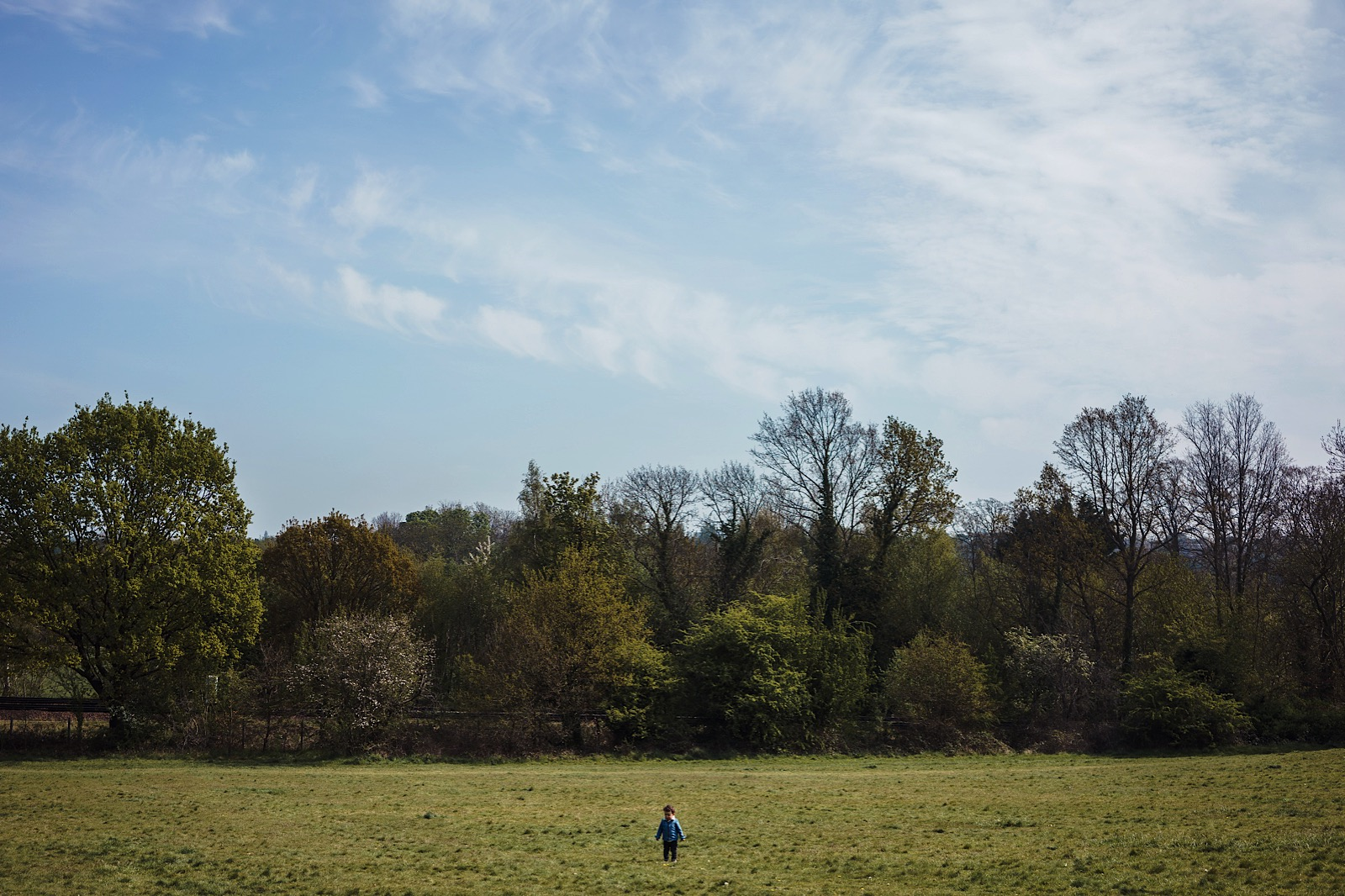image of little boy stood in empty field during covid-19 pandemic