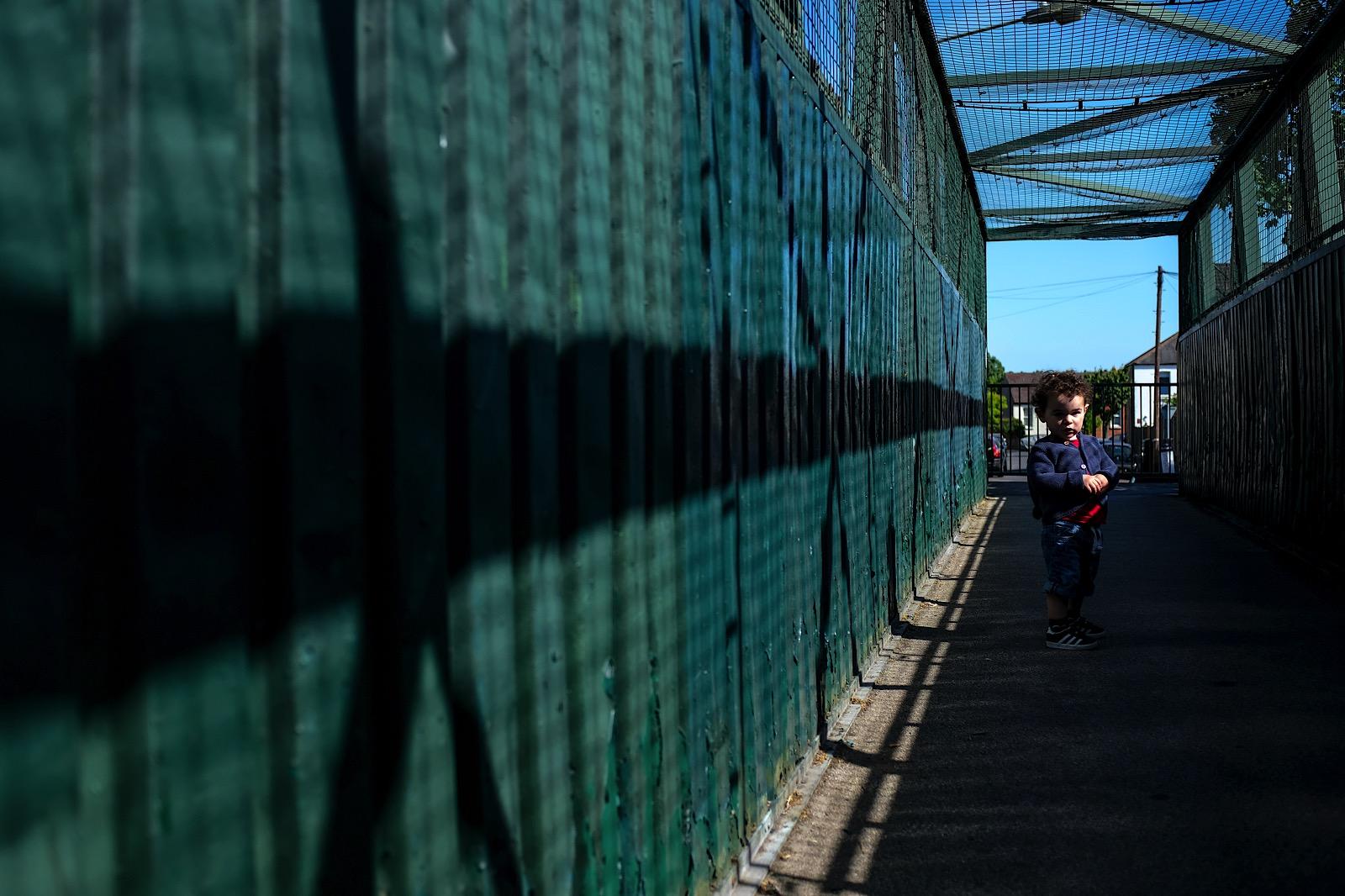 Covid-19 Street Portrait of little boy stood on bridge