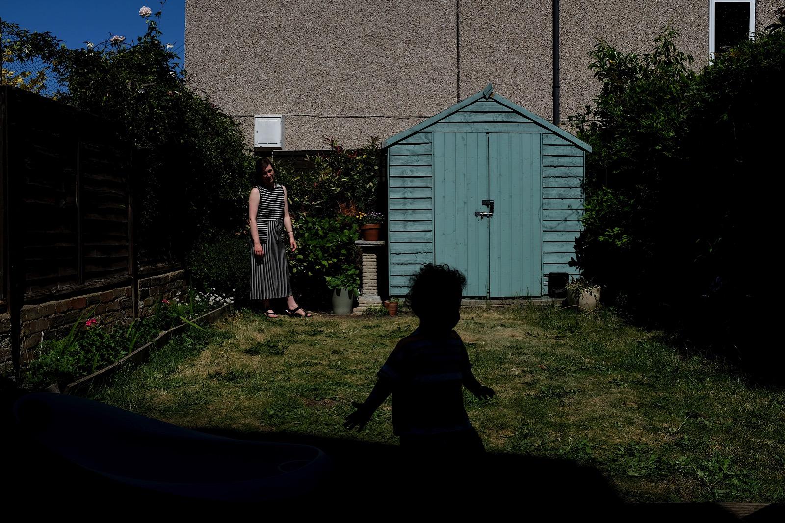 Mother watching child run in Garden