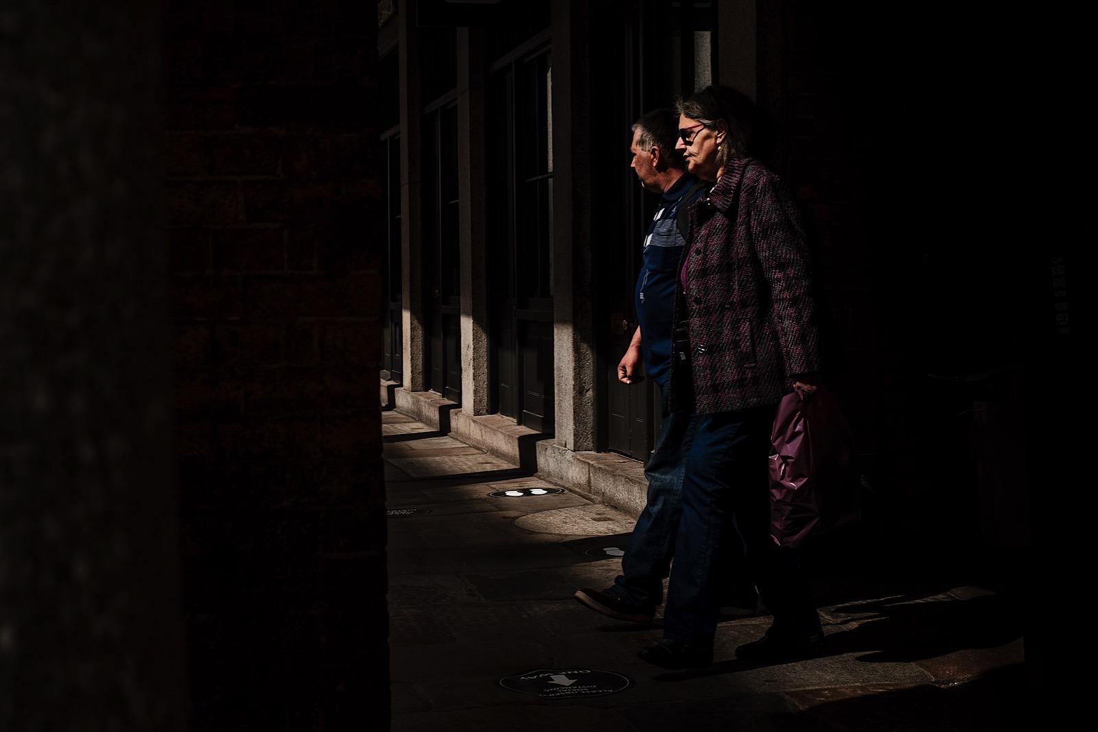 Street Portrait of couple walking in London
