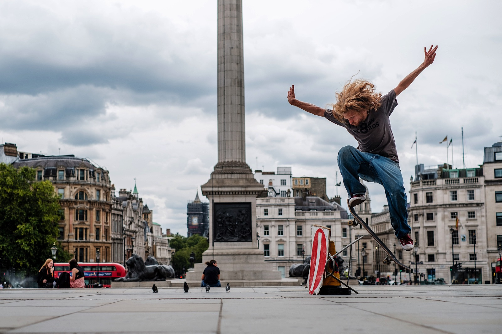 Street Photography portrait of skateboarder at Trafalger Square mid trick