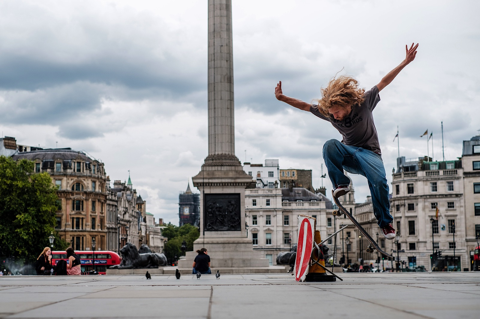 London's Trafalgar Square with skateboarder doing a jump mid air