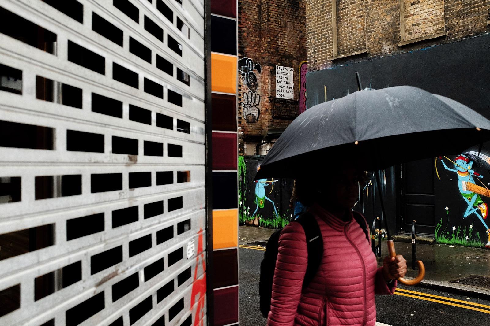 Woman walking in rain in London