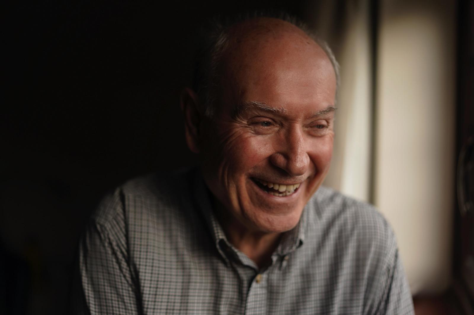 Older man laughing