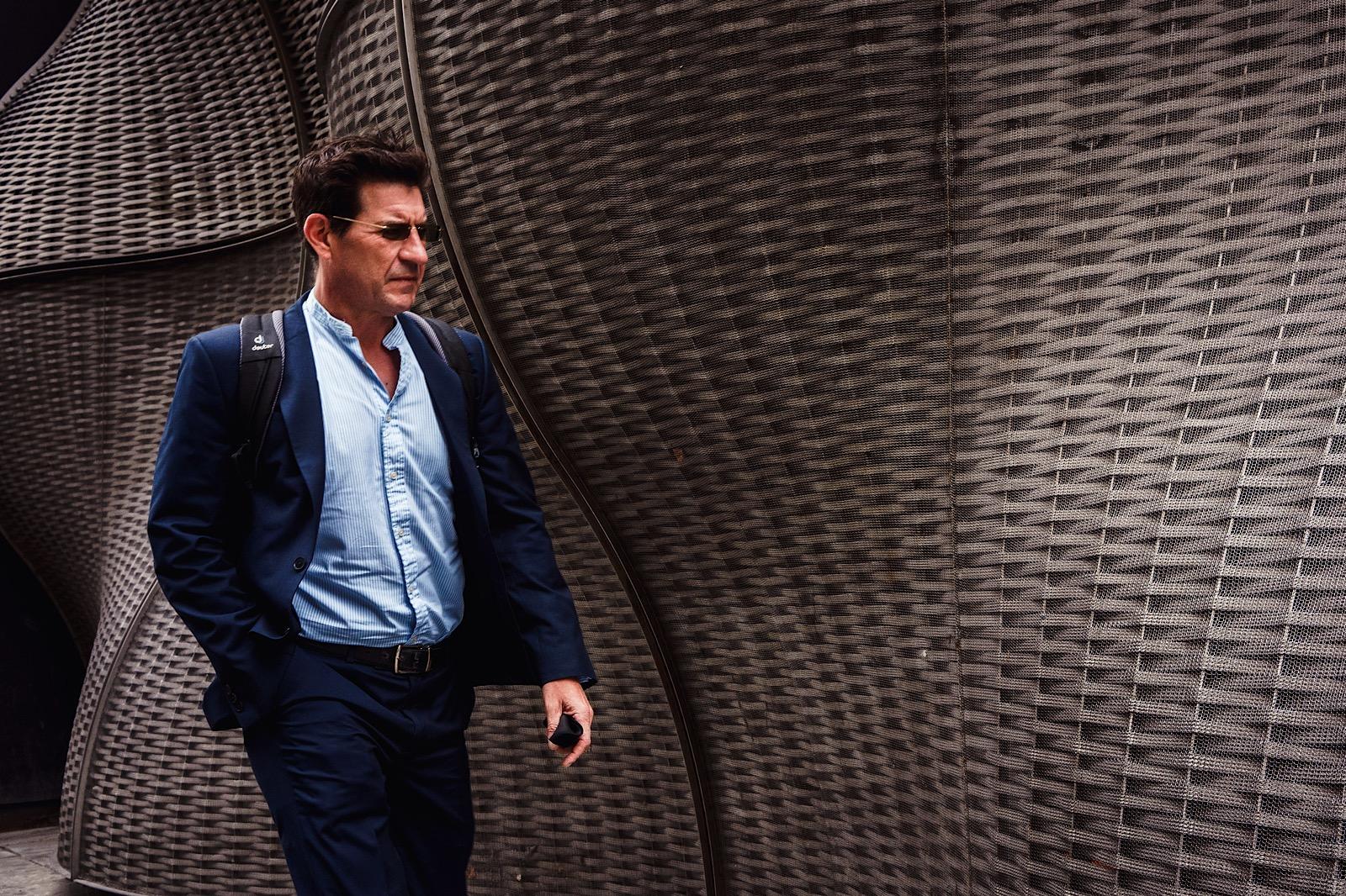 Business Man wearing sunglasses walking in london