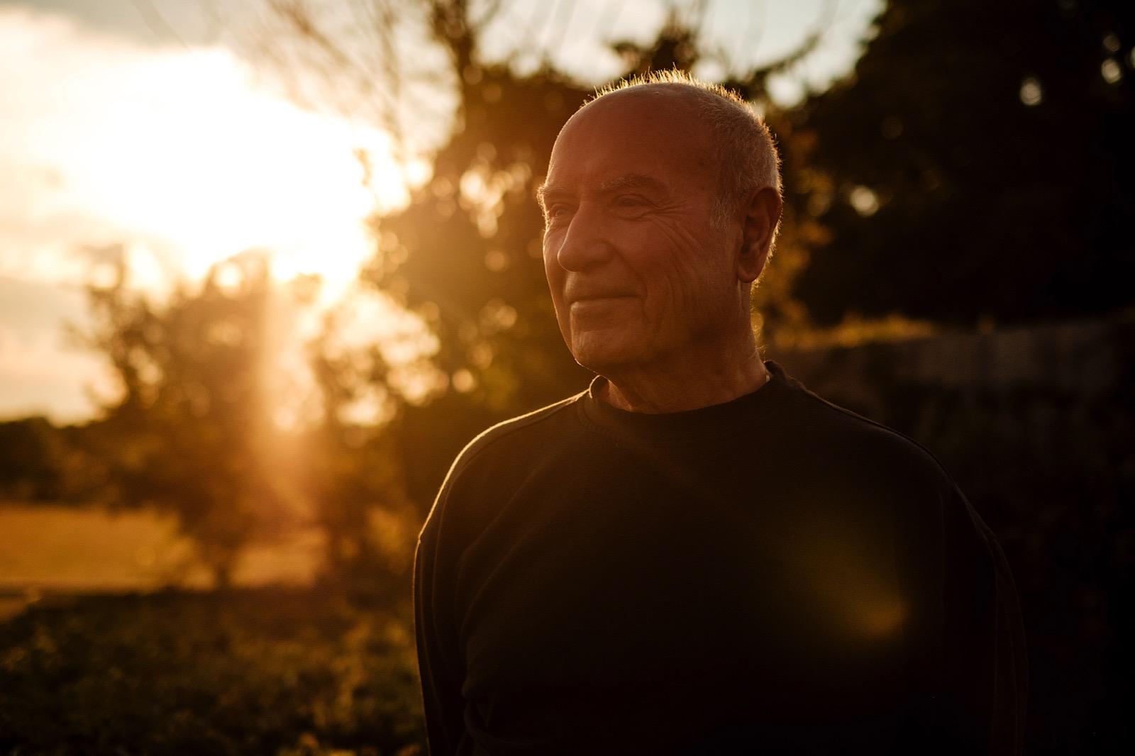 Headshot of gentleman wearing black jumper during golden hour