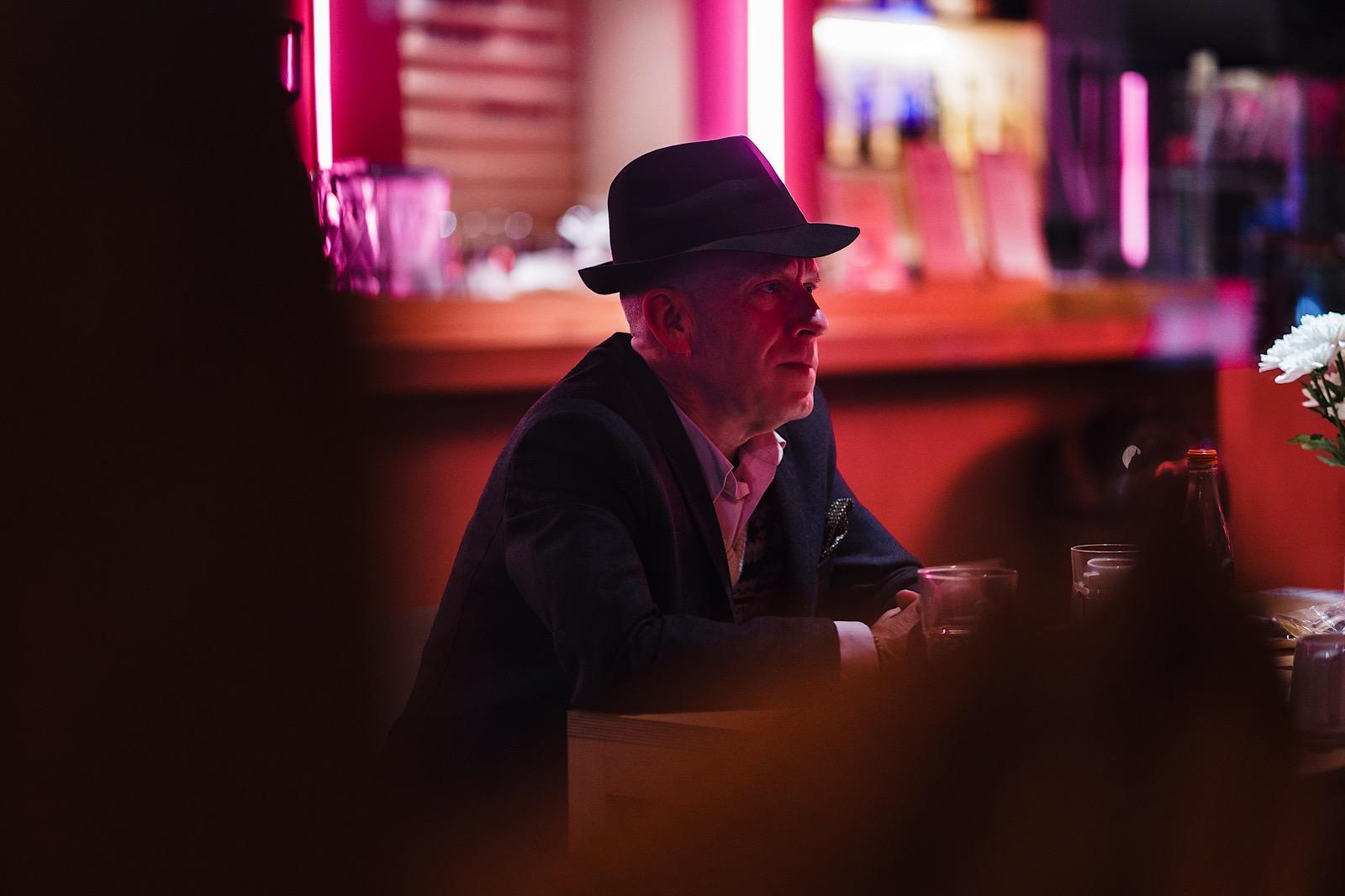 Man wearing hard sat at a table eating