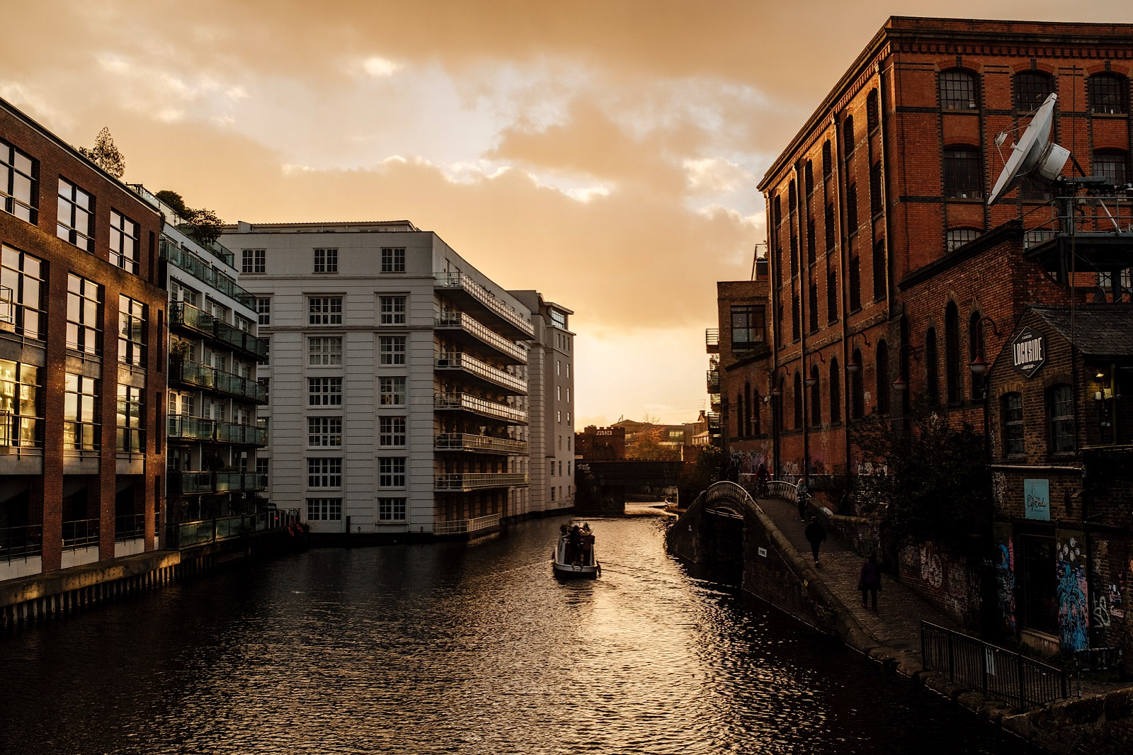 View of buildings in canal lockside sunset scene in London