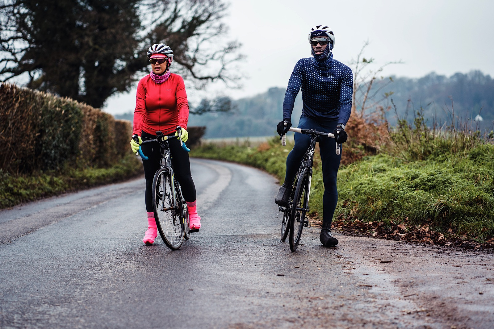 Male and female cyclists on quiet country road for Ride for Unity Charity