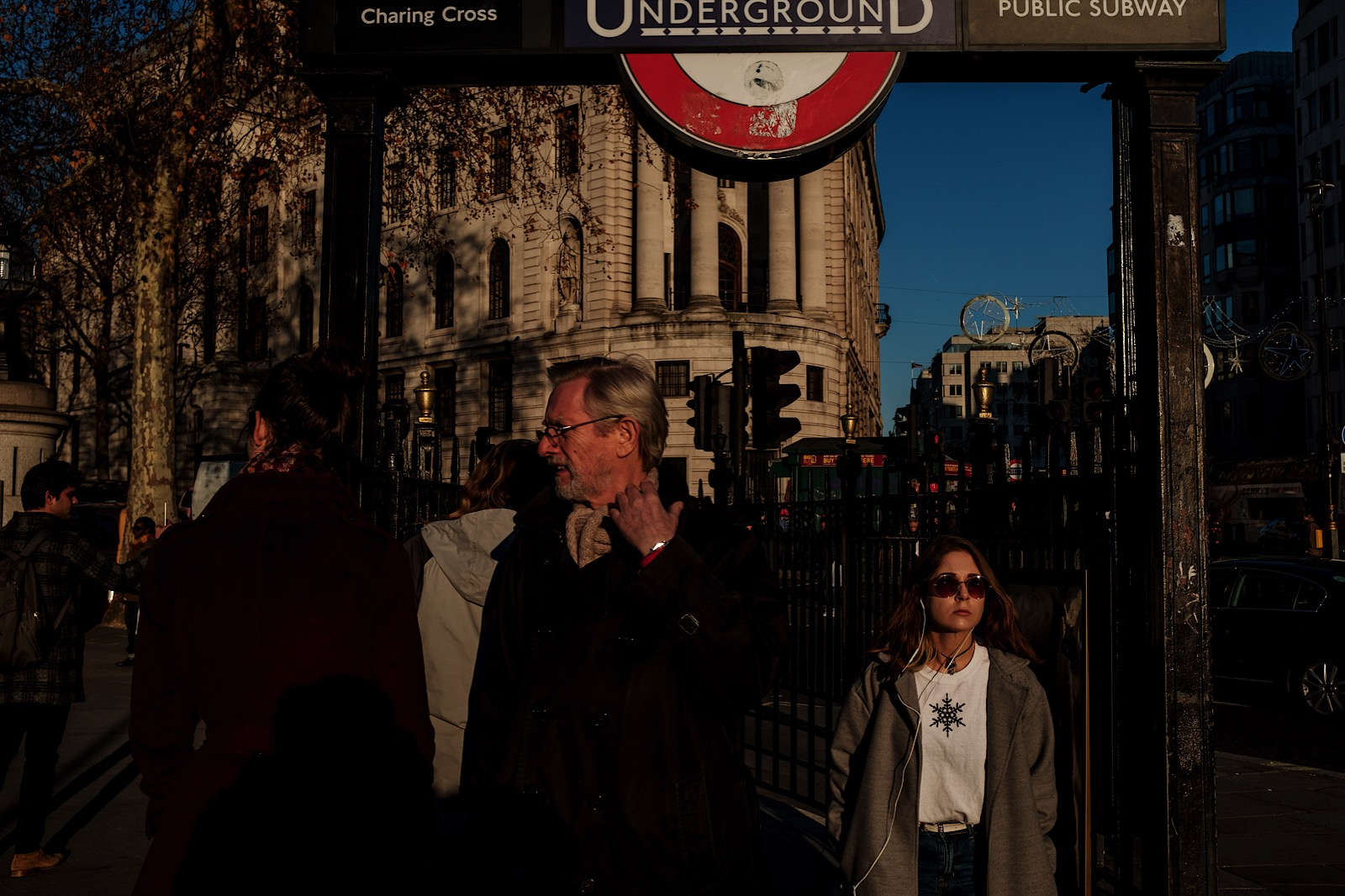 Street Photography in Trafalgar Square showing people coming from underground