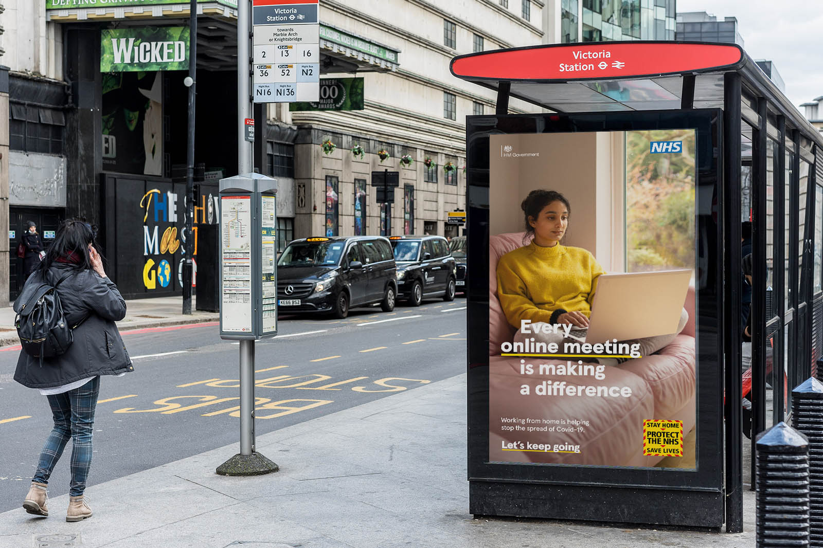 London Street Scene showing advert on busstop from part of the Let's Keep Going NHS and UK government Covid-19 Campaign