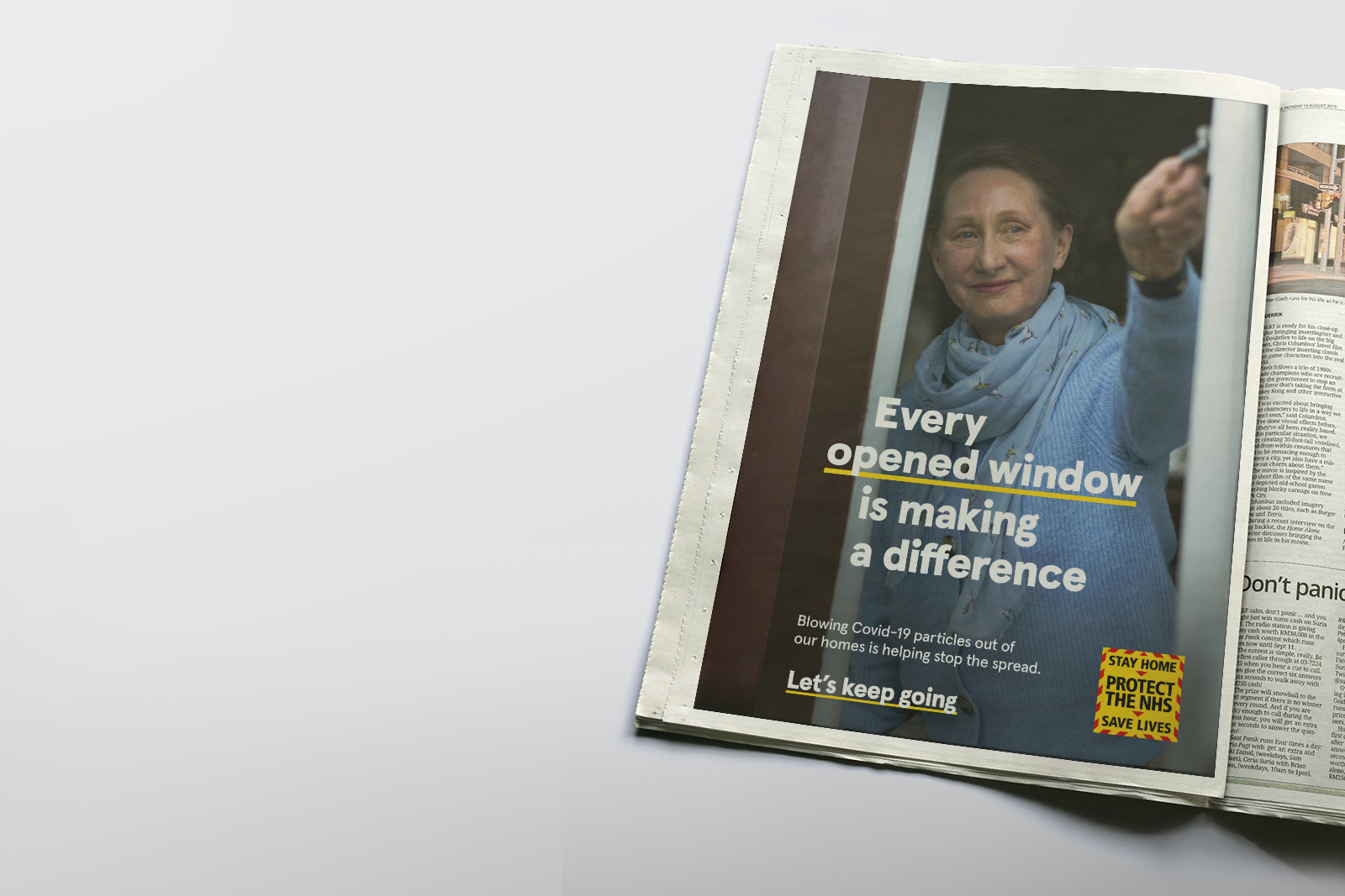 Magazine Image of women opening window as part of the Let's Keep Going NHS and UK government Covid-19 Campaign