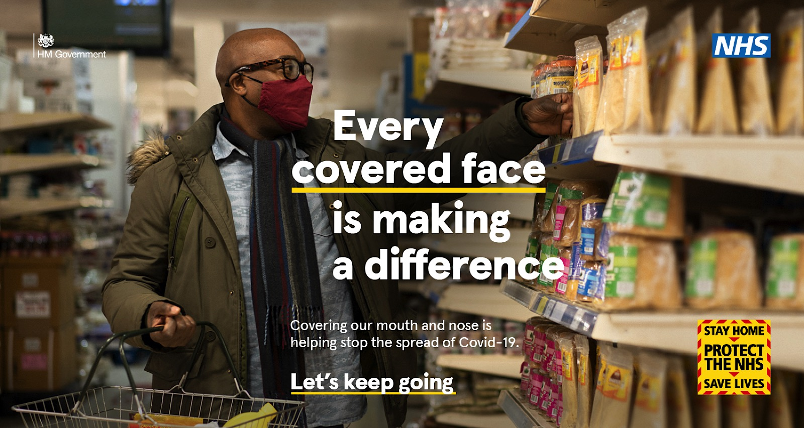 Campaign Image from Let's Keep Going NHS and UK government Covid-19 Campaign showing man in supermarket wearing a mask